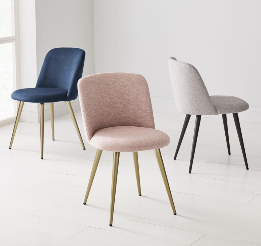 Three chenille West Elm dining chairs in mauve, grey, and navy